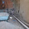 Earthship Construction Update; plaster & plumbing